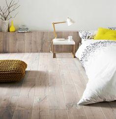 Scandinavian wood bedroom with pop of colour
