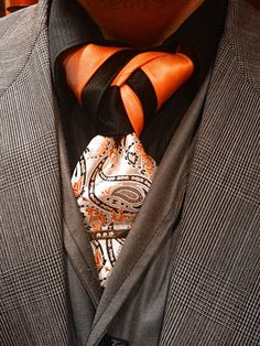 Two ties are better than one. A classic arrangement of orange and black bring a fancy knot to the next level.