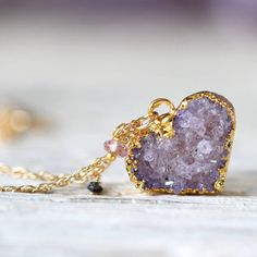 This exquisite crystal heart.   23 Teeny Tiny Amethyst Necklaces That Are Delicate AF
