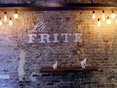 Bricks Restaurant interior design bricks reclaimed wood lighting faux-paint