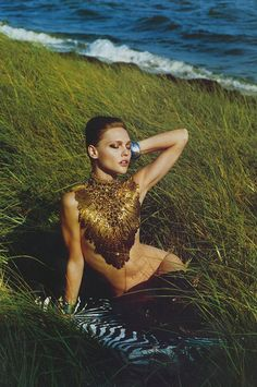 """gold feather top-Sasha Pivovarova in """"Luxury of the Simple Life"""" for Vogue Nippon November 2010 photographed by Alasdair McLellan"""