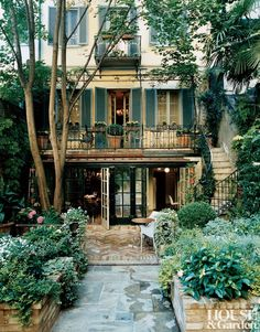 Traditional Garden by Studio Peregalli At a Milan home, the garden is fitted with contemporary and antique furniture.  Architect: Studio Peregalli Photographer: François Halard | Homeowner: Claudio and Maria Luti | Article: A Spirited Adventure, October 2005,  Location: Milan, Italy