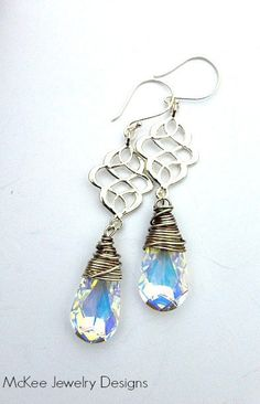 Scrolls. Antiqued sterling silver wire wrapped, Swarovski Crystal Passions diamond shimmer earrings. McKee Jewelry Designs