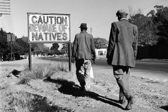 "An image of the actual situation of Apartheid in South Africa. They sign says, ""Caution, beware of Natives"", which of course refers to the native black people of South Africa. Apartheid Museum, Fotojournalismus, Gil Scott Heron, Cape Town South Africa, African History, African Men, Documentary Film, Black People, Old Pictures"