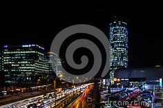 The business district of Bucharest shot at night. The photo shows the busy streets and feel of the area