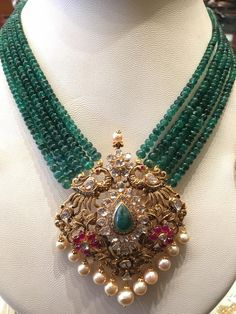 Here are three great emeralds designs with multi layered Emeralds beads sets with beautiful pendants that you should not miss out. Indian Jewelry Earrings, Jewelry Design Earrings, Gold Earrings Designs, Emerald Jewelry, Gold Jewellery Design, Beaded Jewelry, Gold Jewelry, Bead Jewellery, Jewelery