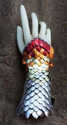 Dragon Skin Gloves, Scale Half Gauntlets Phoenix fire Red, Orange, Gold and Silver With Leather Buckle https://www.etsy.com/listing/159019650/dragon-skin-gloves-scale-half-gauntlets?