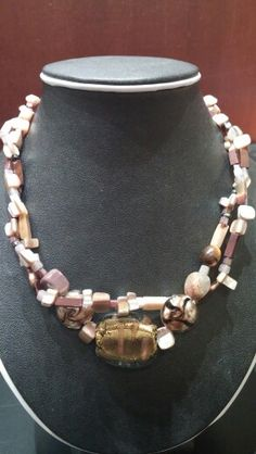 Mother of pearl, mookite, large glass focal,and to lampwork beads, double stranded necklace.
