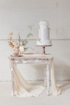This darling little wedding cake table styled by Weddings is just so elegant and romantic. The three tier wedding cake designed by Poppy Pickering Cakes is displayed with a soft runner, neutral pi Wedding Cake Display, Diy Wedding Cake, Wedding Cake Designs, Farm Wedding, Wedding Cake Toppers, Wedding Table, Wedding Favors, Wedding Night, Autumn Wedding