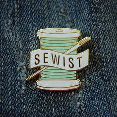 """PREORDER – These will ship on August 9.  """"Sewist"""" is a brand new word that combines sewer and artist. It's a word that defines the modern sewing movement.  Sewists love fabric and thread and the self-expression and empowerment that sewing brings. We're creative and unique and proud to say, """"Yep, I made that.""""  This is a hard enamel pin with gold metal. The pin is approximately 1″ tall and includes a sturdy rubber backing.  Made to last."""