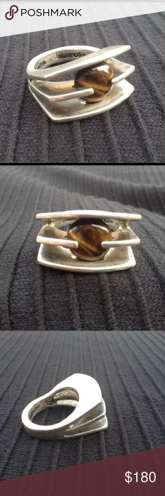 """Vintage Mexico Modernist Silver Ring 1960's silver and tigers eye ooak modernist ring from Mexico. This is a superb example of the shift traditional Taxco silversmithing experienced in the 60s & 70s. Architectural, large, dramatic. The austerity of this piece is brilliantly metered with the round, lifelike tigers eye cabochon. Ring size 9 with a little room. Stamped Mexico & eagle # 2. Makers mark is there but hard to make out, looks like D' Or??ea. Weighs 15g. Apps 1"""" x 1"""". I especially…"""