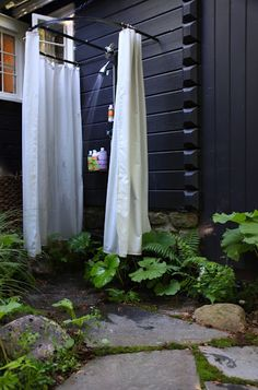 outside shower: haha bringing the inside out, with the shower curtains!