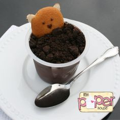 Groundhog Day Dessert (Instructions: Crumble oreo cookies & sprinkle a layer onto a chocolate pudding cup.  Use frosting to creat eyes & a nose as well as 'glue' almost sliver ears onto a vanilla wafer cookie.  Bury the cookie in the dirt cup up to his nose.)
