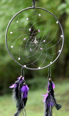 """Bewitching Dreams - You have Bewitched My Mind, Body and Soul - 10"""" dream catcher wrapped in soft black leather - weaved with black sinew and adorned with clear glass teardrop beads, purple glass beads, black and purple feathers and a silver witch charm"""