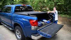 Sample of the Truxedo Truxport rollup bedcover for the 07-14 Toyota Tundra CrewMax pickup trucks with the 5.5 foot short bed WITH the stock bed track system.