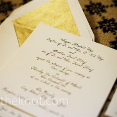 Simple: square, ecru cards printed in a black calligraphy font with Gold Envelopes