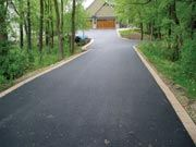 asphalt driveway with ribbon curbing |  Pinned by Tara Blais Davison