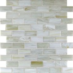 This is another example of glass tile (believe it or not) to be used as an accent. It is subtle gradient of grey with a little tan in there actually. It is in a subway pattern and appears to be stuck together on a mesh for easy installation. What do you think? I will keep looking if I can find this installed in a bathroom as an accent with ceramic white tile, but for now - this is the best that I've got.