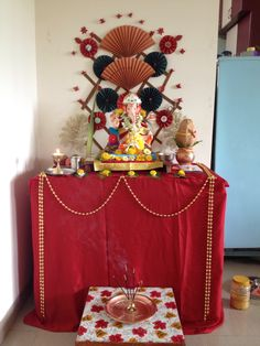 Ganpati decoration with paper fans and flowers Gauri Decoration, Mandir Decoration, Ganapati Decoration, Teen Decor, Boy Decor, Kids Decor, Stage Decorations, Festival Decorations, Paper Decorations