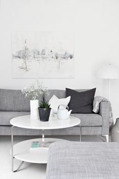We are getting a couch similar to this color, kind of like the white coffee table