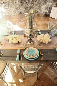 """""""Just because a bride might be saying 'I do' during the winter months, doesn't mean she has to over do it with cliche holiday decor,"""" says @Utah Events by Design: Michelle Cousins, who used Z Gallerie's Alexis Vase, Silver Coral Spray, Madera Dinnerware and Starburst Charger. Photos by Pepper Nix Photography"""
