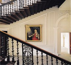 """The Great Staircase at Beningbrough Hall. Portrait by Reynolds of William Pulteney, 1st Earl of Bath. From """"Mlinaric on Decorating""""."""
