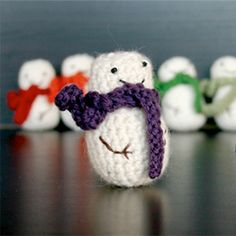 Crochet an army of mini snowmen with this free pattern! - TOO BAD, SO SAD. I ALREADY CROCHETED AN ARMY OF TINY FLAME THROWERS.