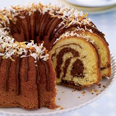 Coconut Marble Cake - Woman's Day. One of my favourite cakes to make but sometimes can be a tad dry. I wonder how this would do as mini-cupcakes?!?!
