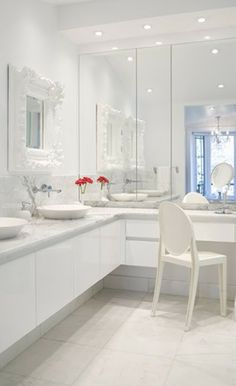 Nice Mirror Installation...The Wall of Mirrors is offset by a Pair of Ornate Mirrors over the Twin Wash Basins...