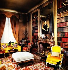 British Royal families prefer needlepoint rugs for their private homes even when they are living in Paris as in this elegant library in the Duke and Duchess of Windsor's Paris home. It was decorated by the famous decorating firm Maison Jansen who later decorated the Kennedy White House. This cream, red, yellow and gold antique needlepoint rug combines architectural and floral elements which sets the tone for this library. The strong needlepoint rug pulls together the brilliant yellows and…