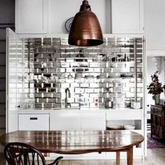 A splashback made from mirror bevelled tiles brings a touch of glamour to this LOVE THIS BACKSPLASH! From 'Mirror Finish', a story on page 184 of Vogue Living Sept/Oct Photograph by Sharyn Cairns. Küchen Design, House Design, Tile Design, Design Ideas, Design Bathroom, Graphic Design, Sweet Home, Mirror Tiles, Kitchen Interior