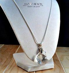 Swarovski sea shell pendant necklace Swarovski by ILoveBeads247 $24 buy follow share