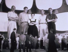"""Charles and Ray Eames and staff in a model of their """"Glimpses of the USA"""" multi screen presentation"""