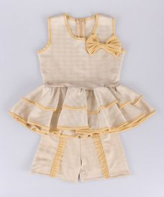 This Stone & Gold Bow Peplum Top & Shorts - Toddler & Girls by Mia Belle Baby is perfect! #zulilyfinds