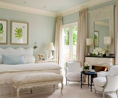 Master Bedroom - Refined, luxurious and traditional. With a quiet neutral color palette, this room is understated luxury in the best of all ways. Small scale Bergere chairs cozy up to the marble fireplace with carved mantle. Crown molding and recessed lighting add finishing touches. French doors lead to the outdoor pavillion. The adjoining sitting room and master bathroom finish our private space.