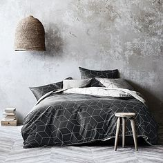 Reflect a modern edge in your bedroom with the soft sateen Sine Quilt Cover Set, Charcoal from Aura by Tracie Ellis.