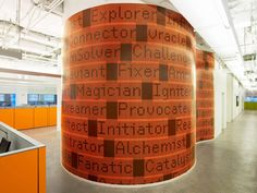 inspirational words on wallcovering cover structural columns - JWT Headquarters in NYC