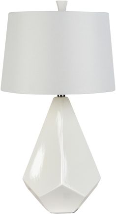 Our Enigma Ceramic Table Lamp White comes to life with an intriguing ceramic base accented by the fixture's angular shape. The white bell shape shade made from faux silk compliments the geometric base perfectly. This decorative lamp will give your space a dressed-to-impress kind of style.