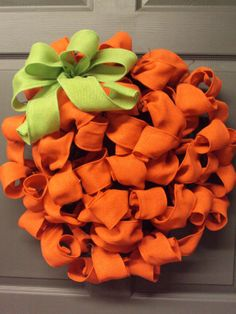 Pumpkin Wreath for Fall made out of orange burlap ribbon