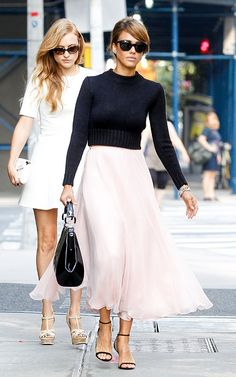 Black, long-sleeve top and a pale pink chiffon skirt. #fashion #outfit #streetstyle