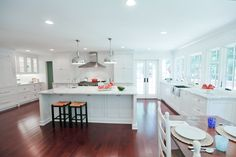 Magazine-worthy kitchen renovation and room addition by Highlight Homes; Image credit: Never the Rock Photography.