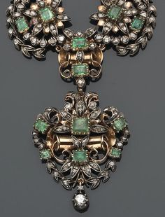 An emerald, beryl, diamond and silver-topped eighteen karat gold necklace  the tapering, scrolled, floral and foliate motif links set throughout with emerald-cut emeralds and foil-back beryl, accented by rose-cut diamonds, suspending a detachable pendant; length: 17in.  [Suspect Georgian, possibly early Victorian]