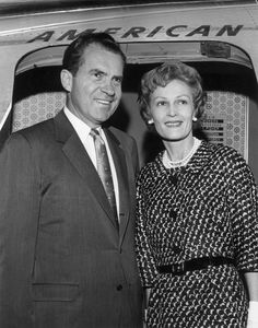 A 1960 photo of then Vice-President Richard Nixon and his wife boarding American Airlines