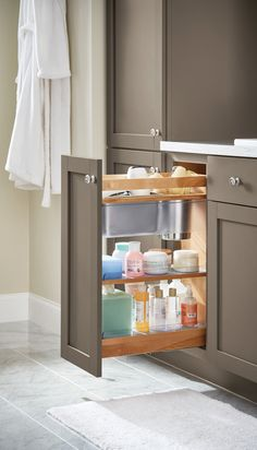 Bathroom Storage Tip: Make the most of your bathroom space with kitchen cabinetry (yes, we're serious!). This pull-out unit has storage for grooming tools and non-slip shelves to keep things in their place. Martha Stewart Living Kitchens are available at @homedepot.