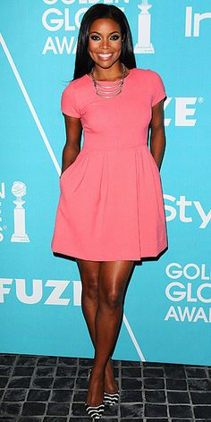 Gabrielle Union. Shoshanna mini, complemented with a multi-chain Dannijo necklace and striped pumps