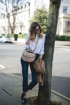 Spring outfit with camel blazer, boyfriend shirt, straight leg jeans and some backless loafers on EJ Style