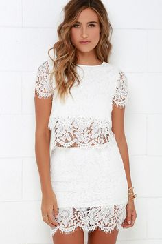 You'll fondly reminisce on all the good times you've had (and will have!) in the Turn Back Time Ivory Lace Two-Piece Dress! Ivory eyelash lace overlay shapes a cute crop top with a round neckline and short sleeves. A second layer of lace drops below the scalloped hem to create a sheer, tiered look. Matching skirt finishes off the set with its figure-accentuating fit and tiered mini-length hem. Top has keyhole and button closure at back. Skirt has hidden back zipper/clasp. Partially lined…