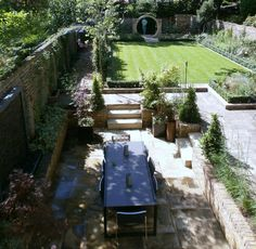 A recently completed large family garden design set in the heart of Barnes South West London. Building A Pool, Listed Building, Outdoor Dining, Dining Area, Outdoor Decor, London Garden, Family Garden, Patio, West London
