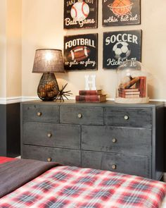 A kid's — or teen's — room doesn't have to be designed with a typical pink or blue color scheme. This neutral-hued room still feels fun and youthful with the addition of retro-inspired sports art. Plaid linens lend a rustic and comfortable air.