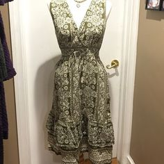 Womens print dress This is a really light beautiful army green print dress with white detail and a little bit of gold in there too. This is a great Spring & summer dress!! V cross neck front with small waist tie in front. Mix Nouveau New York Dresses Midi